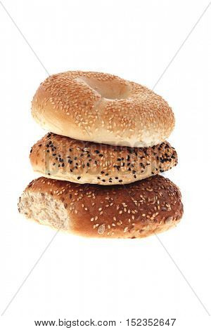 three different fresh bagels  isolated over white background