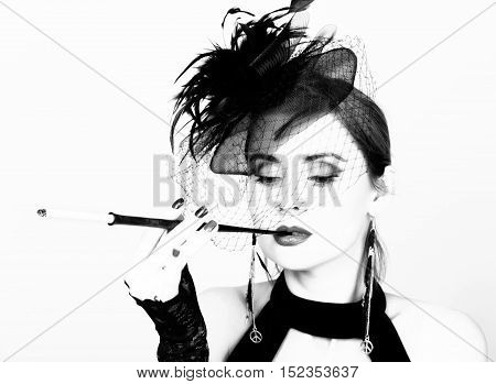 Beauty retro female model with professional makeup and mouthpiece in hand.