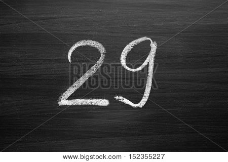 number twenty nine enumeration written with a chalk on the blackboard