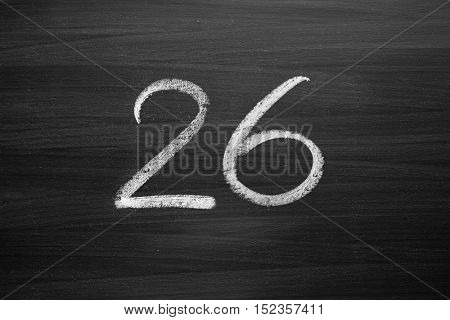 number twenty six enumeration written with a chalk on the blackboard