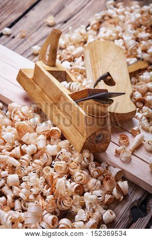 Wooden planer, natural building materials, woodwork and antique hand tools, carrying out carpentry, tool kit for joinery, wood sawdust