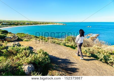 Woman walking along the heritage trail at Port Elliot Horseshoe Bay South Australia