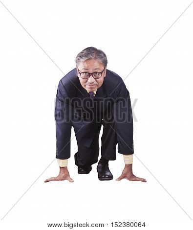 60s years asian business man posting as runner on start approach for running competition isolate white background
