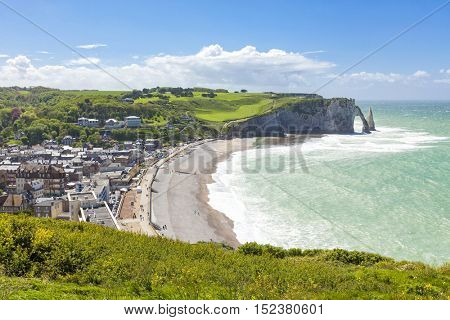 View over Etretat with its famous natural arch and pinnacle rocks