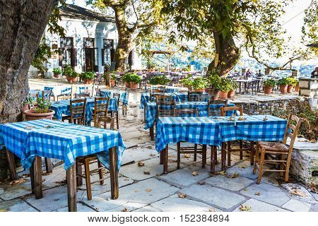 Typical greek tavern, restaurant or cafe view at Makrinitsa village of Pelion, Greece