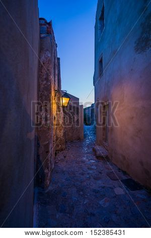 The beautiful Byzantine castle town of Monemvasia in Laconia at night. Peloponnese - Greece.