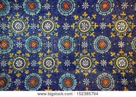 Ancient mosaics (V century) on a ceiling in the Mausoleum of Galla Placidia in Ravenna, Italy