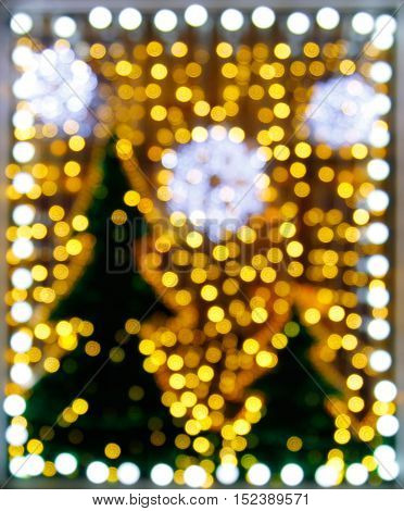 Abstract christmas tree background with defocused lights on the storefront