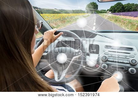 Self-driving car concept - woman driving modern car