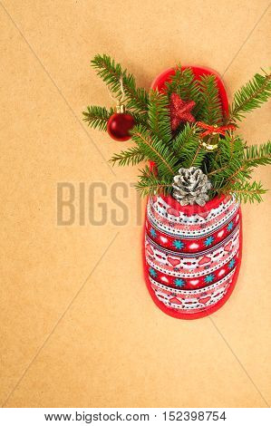 Christmas Fir-Tree With Decorative Balls In One Red Slipper With Patterns On Wooden Background. Christmas Tree With Decorations In Slipper. Christmas Composition.