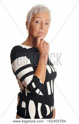 thoughtful older woman with hand on chin. isolated on white.
