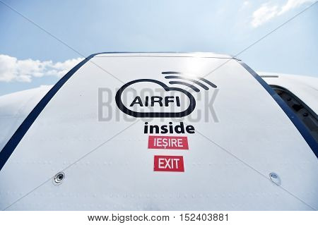 Airfi system sign the wifi solution for airplanes is seen imprinted on airplane door