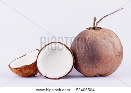 fresh coconut half clipping path for coconut milk and brown coconut shell and ripe coconut  on white background healthy fruit food isolated