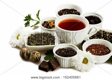 Cup of Black Tea with Dried Leaves Tea in Bowls