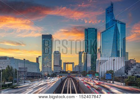 La Defense, Paris. Image of office buildings in modern part of Paris- La Defense during beautiful sunset.