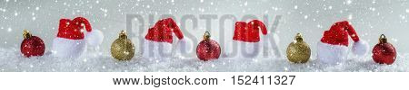 Christmas background with Christmas balls and cap of Santa Claus. Panoramic image
