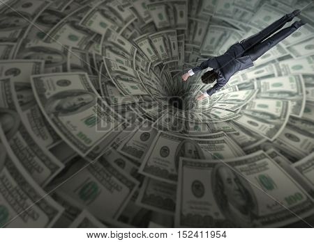 Businessman fighting against dollar funnel