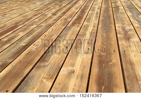 A sanded wooden deck prepared for application of stain.