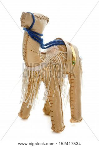 camel toy in front of white background