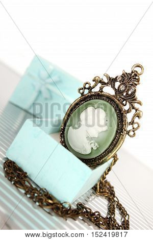 Close-up of vintage pendant in gift box