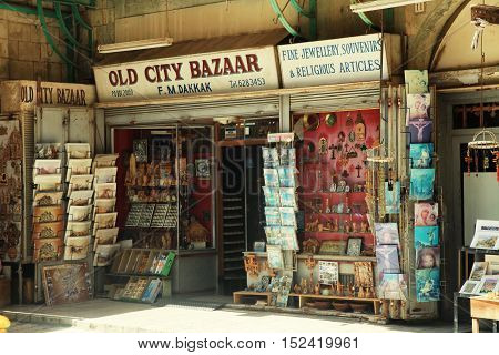 JERUSALEM, ISRAEL - AUGUST 23, 2016: Gift shop in Old City of Jerusalem - one of the oldest cities in the world and holy in Judaism, Islam and Christianity.
