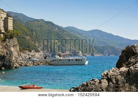 LIGURIA, ITALY - SEPTEMBER 2016 : Tourist passengers getting off ferry ship at Monterosso al Mare, commune town in La Spezia province, Liguria region, Northern Italy on September 22, 2016.