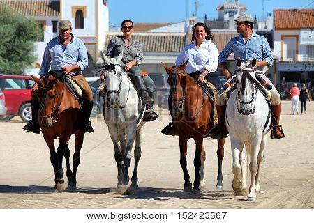HUELVA/SPAIN - 9 OCTOBER 2016: Piligrims riding horses on the way to the shrine of El Rocio for the Sunday holy mass