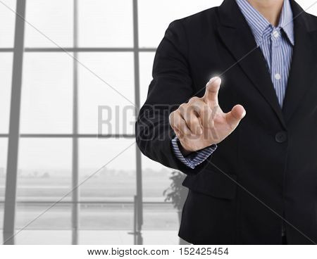 Businessman pointing on virtual screen concept modern business background - can be used for montage your text or pictures.