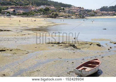 ALDAN, SPAIN - AUGUST 9, 2016: People having a bath in the beach of the village of Aldan Galicia Spain