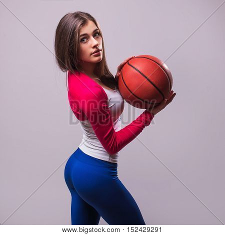Standing Girl With A Basketball Isolated