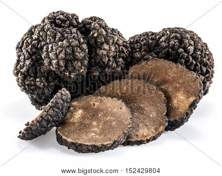 Black truffles isolated on a white background.Truffles slices.