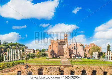 Forum Romanum ruins with cityscape of Rome with sunrise light, Italy