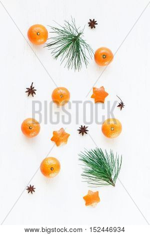 Christmas composition. Christmas pattern with tangerines pine branch anise star. Flat lay top view