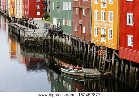 Trondheim, Norway - September 26, 2015: View of old wooden storehouses near by the river Nidelva seen from The Old Town Bridge.