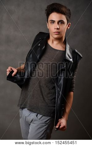 Elegant young man. Studio fashion portrait.
