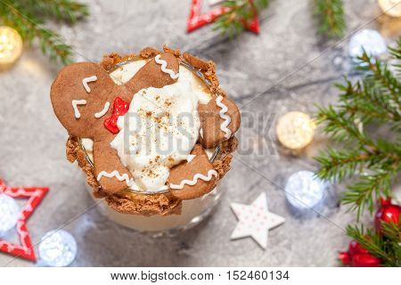 Drunken Gingerbread cookie man in a Christmas cocktail