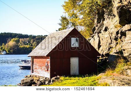 traditional scandinavia falun red wooden cottage house at fjord