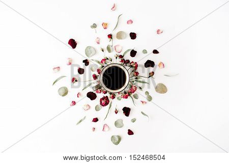 black coffee mug and red rose buds bouquet with eucalyptus on white background. flat lay top view