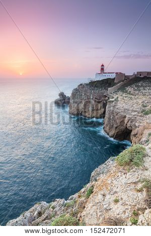 View of the lighthouse and cliffs at Cape St. Vincent at sunset. Continental Europe's most South-western point Sagres Algarve Portugal.