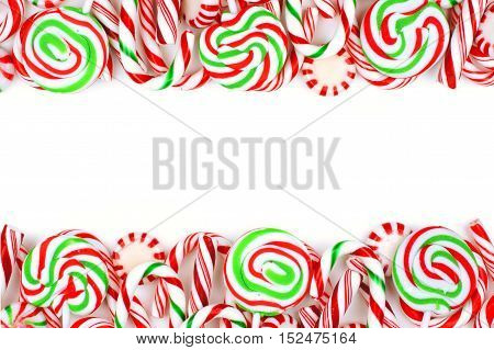 Christmas Candy Double Border With Lollipops, Peppermints And Candy Canes Over A White Background