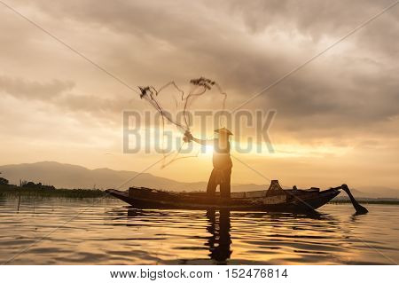Silhouettes of the traditional fishermen at the sunset near Galle in Sri Lanka.