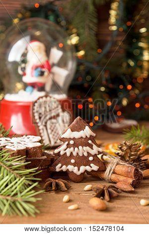Christmas Gingerbread Cookies Against Background Sphere With Santa Klaus