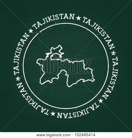 White Chalk Texture Rubber Seal With Republic Of Tajikistan Map On A Green Blackboard. Grunge Rubber