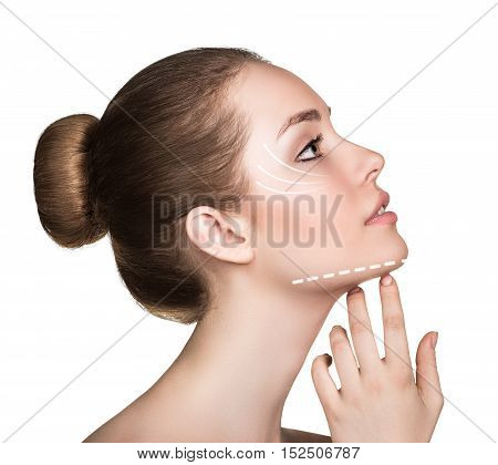 Woman touching her face with lifting arrows isolated on white. Plastic surgery, aging concept.