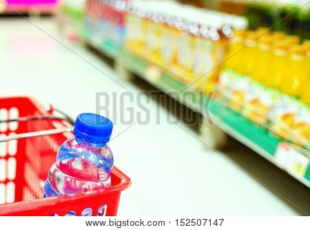Supermarkets drinks and mineral water on the shelves closeup.
