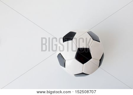 sport, football and sports equipment concept - close up of soccer ball over white background from top
