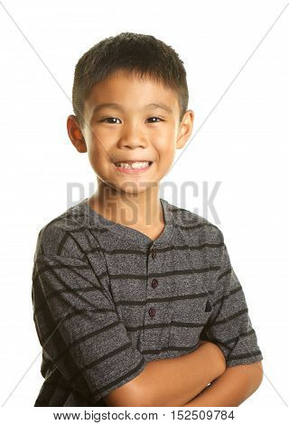 Cute Filipino Boy on a White Background smiling.