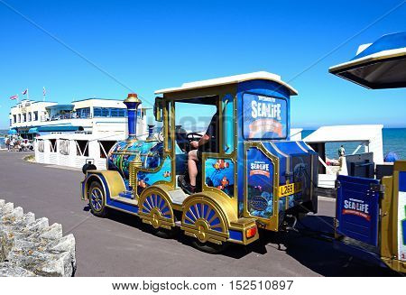 WEYMOUTH, UNITED KINGDOM - JULY 18, 2016 - Tourist train heading towards the Pier Bandstand along the Esplanade Weymouth Dorset England UK Western Europe, July 18, 2016.
