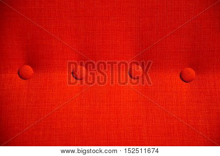 red fabric sofa with clasper pattern texture