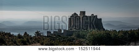 Dark Profile of medieval castle of Loarre on top of hill in Aragon, Spain